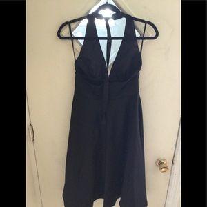 Fully lined halter back dress.